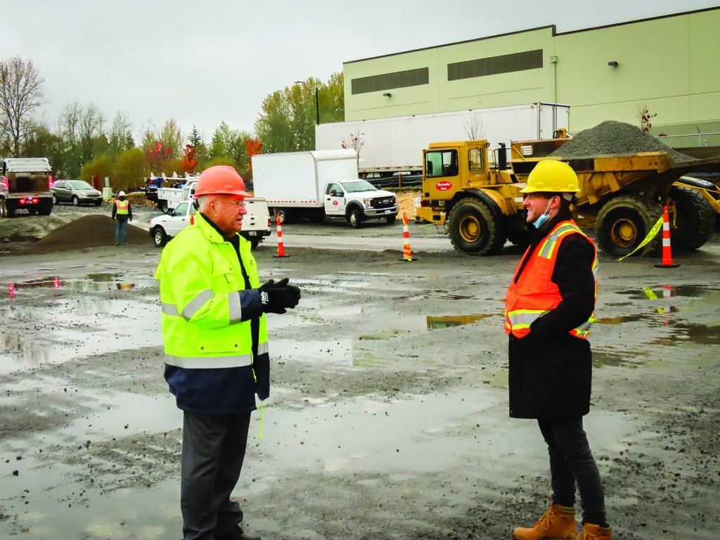 Port of Ridgefield Commissioner Joe Melroy, (left) and Ethan Perry, business development staff and project manager, confer at the port-owned Ridgefield industrial site where two new metal buildings, comprising a little over 43,000 square feet of space for lease in early 2021, are rising from the ground.