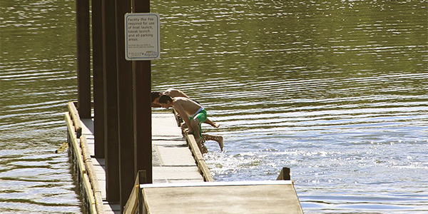 Kids swimming at boat launch