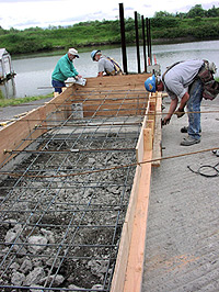 Contractors working on boat launch